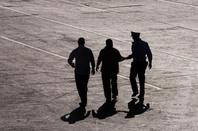 Arrested, image via Shutterstock