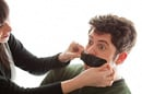 Tape over mouth, image via Shutterstock