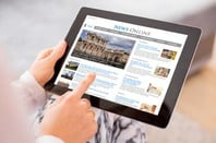 Sample news website on digital tablet. Copyright: Kaspars Grinvalds/shutterstock.com