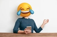 "Woman with ""crying with laughter"" emoji for a head... photo by Shutterstock"