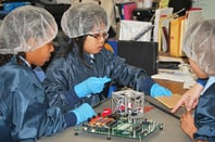 St. Thomas More Cathedral School work on their CubeSat. Pic: NASA