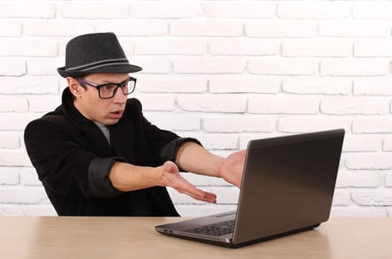Laptop user, photo via Shutterstock