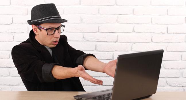 Laptop user, photo via Shutterstock