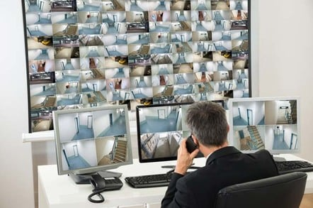 home office it. security guard watches footage from hundreds of camera photo by shutterstock exclusive the uk home office it