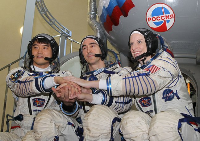 Anatoly Ivanishin, Takuya Onishi and Kate Rubins pose at Baikonur. Pic: NASA