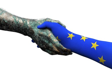 Hand painted with EU flag shakes robot hand. Photo by Shutterstock