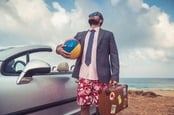 "Guy in shirt and tie visits the beach. wearing ""beach business-casual"". Photo by Shutterstock"