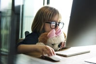 Girl and computer, photo via Shutterstock