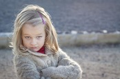"""Little girl looks at camera with an I told you so""""attitude."""