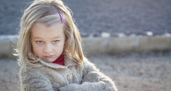 """Little girl looks at camera with an """"I told you so"""" attitude. Photo by Shutterstock  Release Information: Signed model release filed with Shutterstock, Inc"""