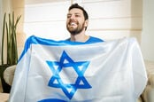 Happy man holds flag of Israel. Pic: Shutterstock