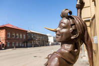 Samara, Russia: Fragment of bronze monument fairy-tale characters - Buratino (*character based on Pinocchio) near the museum Aleksei Tolstoi in sunny day
