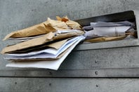 letters stuffed in a mailbox. Photo by SHutterstock