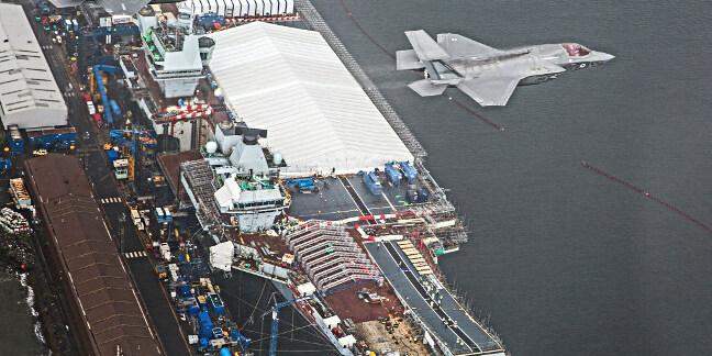 F-35Bs fly past HMS Queen Elizabeth at Rosyth dockyard, Scotland. Crown copyright