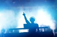 DJ at mixing deck. Photo by Shutterstock