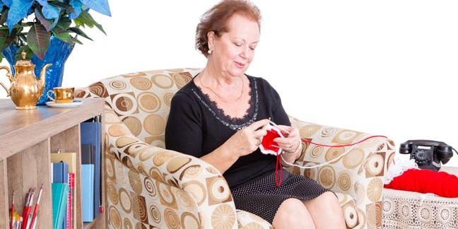 Grandmotherly woman knits. Photo by shutterstock