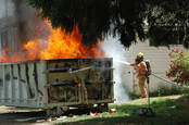 A burning dumpster