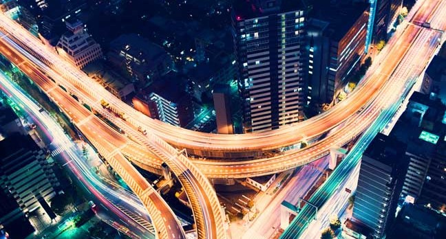 Road at night image via Shutterstock