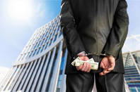 A businessman in handcuffs