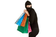 Woman in balaclava with shopping bags. Photo by Shutterstock