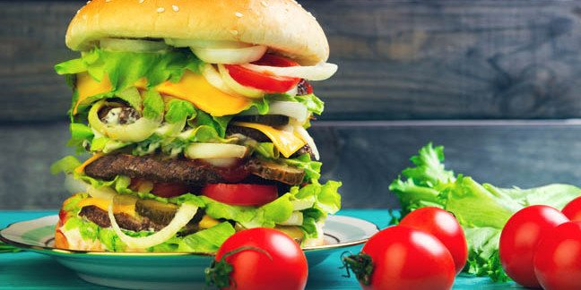 Multi-level burger too big to eat. Photo by Shutterstock