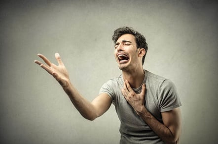 Comically sad tearful man doing fake-looking wail of despair. Photo by Shutterstock