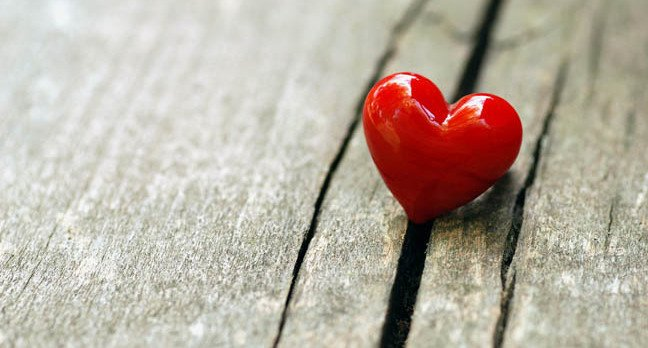 Heart falls into crack. Photo by Shutterstock