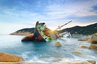 wrecked cargo ship abandoned on sea bay. pHOTO BY shUTTERSTOCK