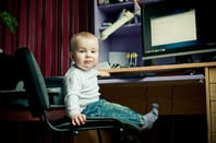 Baby on a computer. Photo by Shutterstock