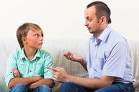 Hipster dad explains facts of life to teen son. Photo by shutterstock