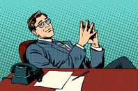 Boss leans back comfortably in desk. Pic via Shutterstock
