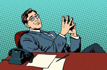 Boss leans back comfortably in desk. Pic via Shutterstock