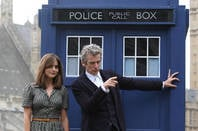 peter capaldi as the Doctor and  jenna coleman as the assistant in front of the Tardis - from bbc kids fantasy series Doctor Who