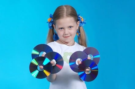 Little girl holds bluray discs up. photo by shutterstock