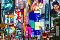 Ads on Times Square. Photo by Allen G via Shutterstock editorial use only