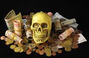A skull atop money