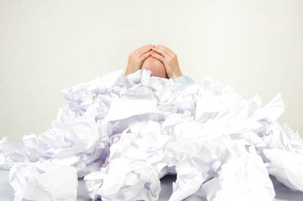 A man buried in paperwork