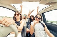 Women having fun in convertible (no seatbelts though). Photo by shutterstock