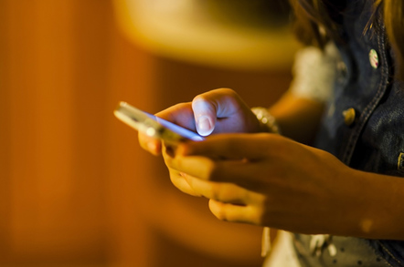 Smartphone user photo via Shutterstock