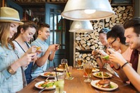 Millennials snap pics of their food with smartphones for Facebook/Twitter/instagram. Photo by shutterstock