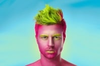 Handsome man has fuchsia-painted skin. Photo by Shutterstock