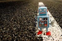 Robot on road photo via Shutterstock