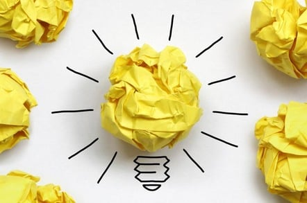 """Idea conceptual illustration: Loads of crumpled up balls of paper and one """"shining lightbulb one"""" (the good idea). Photo by Shutterstock"""