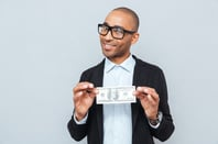 Nerd plus dollar, photo via Shutterstock
