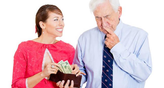 A man handing out cash