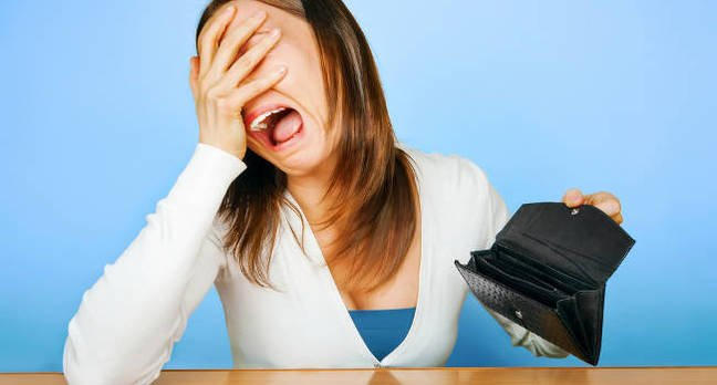 An upset woman with an empty wallet