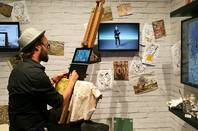 An artist sketches with Yoga Book