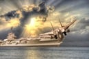 aircraft takes off from carrier, enters clouds. Photo by shutterstock