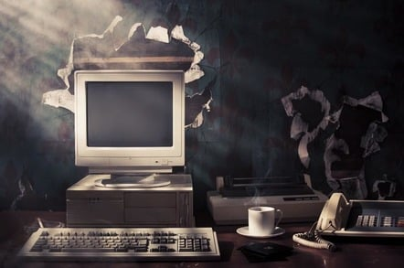 Vintage PC with floppy drive, dot matrix printer and old school desk phone, steaming coffee: a still life. photo by Shutterstock