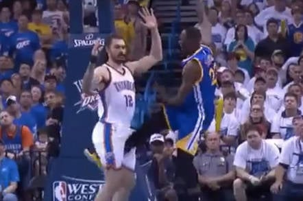 Golden State Warriors player kicking a rival